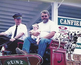 At the 1997 fair, Gary Hemphill Sr. of North Jackson got to ride on the wagon in the Heinz Hitch attraction. Above, his granddaughter Abby, who was born in May of that year, rides along. Hemphill said Abby is now 13 and hasn't missed one day of the Canfield Fair.
