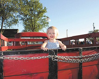 Payton Zwingler of Columbiana, daughter of Chad and Alyson Zwingler, was only a year old when she visited the farm equipment display at the fair. Her parents say they come from a Òhuge family of fair loversÓ and even camp out at the fair.