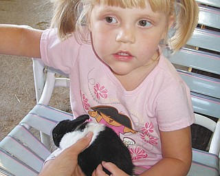 Lindsey holds a bunny at the fair. Photo submitted by Danielle Springer of Detroit, Mich.