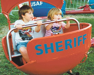 Leanna and Aaron Hartsough of Canfield are on one of the many rides in Kiddie Land.