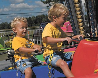 Alex LaPlante, 2, and his brother Nicholas, 5, both of Poland, enjoy the rides at the 2007 Canfield Fair. The shot was taken by their father, John LaPlante.