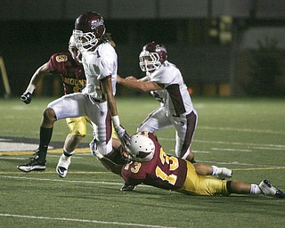 Dayne Hammond (#1) is seen here during Cardinal Mooney's win over Boardman in the 2010 season. Hammond had planned on playing for Warren G. Harding this year.