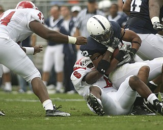 ROBERT K. YOSAY | THE VINDICATOR..YSU #6  Deonta Tate brings down #22 PSU Evan Royster at the line during second quarter action as  #44 Andrew Johnson gets in a hand.YSU  LOSES 44-14   PENN STATE at BEAVER STADIUM IN HAPPY VALLEY.-30