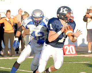 Hubbard linebacker #42 Blake Novotny puts the pressure on Warren JFK quarterback #1 Zach Nicholas.