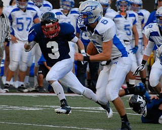 Hubbard Quarterback #6 Michael Lopuchovsky breaks off a 66 yard touchdown run while avoiding the would be tackler of #3 Patrick Hull.