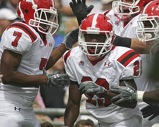 ROBERT K. YOSAY | THE VINDICATOR..***** 80  Yard romp for YSU first touchdown  is  YSU #29  Dominique Barnes   as he was congratulated by teamates #7 Ely Ducatel and #72  Andrew Radakovich -YSU first TD .YSU  LOSES 44-14   PENN STATE at BEAVER STADIUM IN HAPPY VALLEY.-30