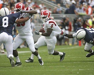 ROBERT K. YOSAY | THE VINDICATOR..Second quarter action as  YSU #5 Randy Louis gets caught by PSU  #15 Bany Gbadyu making the block is #29 YSU  Dominique Barnes on #8 PSU D'Anton Lynn- he made the first down..YSU  LOSES 44-14   PENN STATE at BEAVER STADIUM IN HAPPY VALLEY.-30