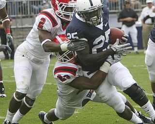 ROBERT K. YOSAY | THE VINDICATOR..YSU #23  Nick Gooden Tackles  #25 PSU  Silas Redd with the help of YSU #2  Andre Elliott during third quarter action..YSU  LOSES 44-14   PENN STATE at BEAVER STADIUM IN HAPPY VALLEY.-30