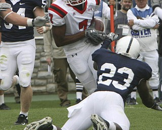 ROBERT K. YOSAY | THE VINDICATOR..YSU #7 Ely Ducatel  Dives for the end zone for YSU Second TD as PSU #23  S.  Obeng-Agyapong (ok) Misses te tackle.YSU  LOSES 44-14   PENN STATE at BEAVER STADIUM IN HAPPY VALLEY.-30