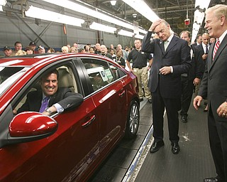 ROBERT K. YOSAY | THE VINDICATOR..GM North America President  Mark Reuss - behind the wheel - Lee Fisher and  Gov. Ted Strickland aas it comes off the GM Lordstown  Kicked Off the Chevy Cruze today at the Lordstown Plant  with the President of GM - Tim Ryan - The Boardman Band and a slew of elected officials -..-30-..