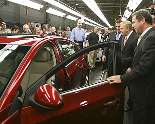 ROBERT K. YOSAY | THE VINDICATOR..GM North America President  Mark Reuss -  Gov. Ted Strickland and Sherrod Brown inspect a Cruze as it comes off the GM Lordstown  Kicked Off the Chevy Cruze today at the Lordstown Plant  with the President of GM - Tim Ryan - The Boardman Band and a slew of elected officials -..-30-..