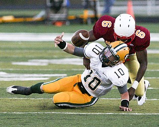 ROBERT K. YOSAY | THE VINDICATOR..CM  #6 Jarvis Abrams brings down St Eds #10 Kevin Burke and jars the ball loose during first quarter action - Cardinal Mooney vs St. Ed's  at Fitch Stadium..-30