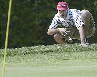 William D. Lewis| The Vindicator  Michael McClure lines up a shot at Greatest Golf Tourney Saturday.