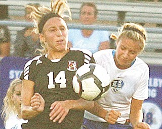 (14) Meredith Gleichert of Canfield and Lindsey Clark of Lakeview fight for the ball Monday night in Lakeview.
