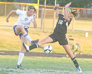 (6) Ali Gagne of Lakeview and (16) Kaylee Buchenic fight for the ball Monday night in Lakeview.