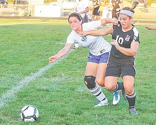 (10) Paige Baker of Canfield and Desiree Nuss (4) of Lakeview fight for the ball Monday night in Lakeview.