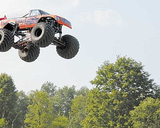 Joe Sylvester III of Boardman soars in his monster truck, Bad Habit, during his world-record-breaking jump Sept. 5.
