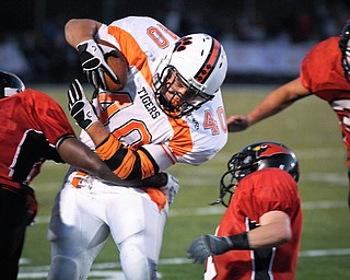 Howland's (40) number not on roster) tacks on yards against the Canfield defence after a short reception during their game on Friday. Photo/Mark Stahl