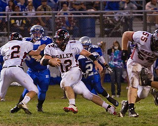 Geoffrey Hauschild|The VIndicator.Salem's Trent Toothman (12) is able to push through the Hubbard line, taking advantage of blocks from teamates Steve Manypenny (52) and Mike King (55) while running downfield during the second quarter of a match up between Salem and Hubbard at Hubbard Stadium on Friday evening.