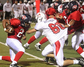 FITCH - (51) Jeff Protain tries to hold off (68) Mike Aylward as (2) Demitrious Davis looks for yards during their game Friday night in Austintown. - Special to The Vindicator/Nick Mays