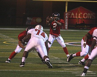 FITCH - Quarterback (2) Demitrious Davis grabs the snap during their game Friday night in Austintown. - Special to The Vindicator/Nick Mays