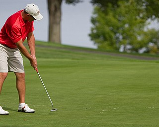 Geoffrey Hauschild|The Vindicator Mike Porter of Tippecanoe, sinks his final put on the 18th hole at The Lake Club during the open division of the Greatest Golfer in the Valley tourney, which he won by one stroke.