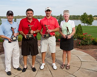 Geoffrey Hauschild|The Vindicator Flight 2 winner, James Lapolla, of Trumbull CC, Flight 3 winner, Tom Onesti, of The Lake Club, Open division winner Mike Porter, of Tippecanoe, and Ladies winner, Joan Ash, of Mill Creek, hold their trophies at the Lake Club on Saturday afternoon following the conclusion of the open Greatest Golfer in the Valley tourney.