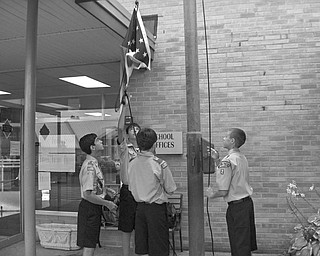 Patriotic pupils, a pledge and a prayer: Boy Scouts Christopher Perry, Jared Argiro, Patrick Brennan and John Brennan commemorate the beginning of the first day of school at Holy Family School in Poland. The Pledge of Allegiance and an opening prayer were said before students were led into the school by their teachers.