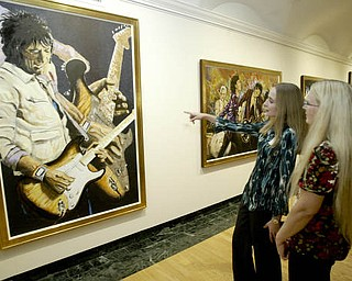 William D. Lewis The Vindicator Sarah Hoefert, left, and her mother Laurie Hoefert of North Lima look at Ronnie Wood art at the Butler Museum of American Art Sept. 21, 2010.