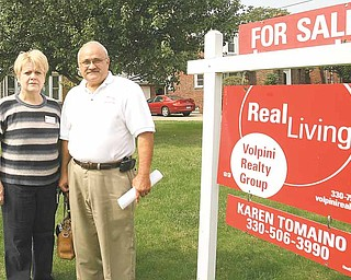 Karen and John Tomaino, real-estate agents with Real Living Volpini Realty Group, talk about safety precautions they and other agents use when showing homes. John Tomaino, a former law-enforcement officer, said he hopes the recent violent crimes against local agents encourage agencies to review their safety procedures.