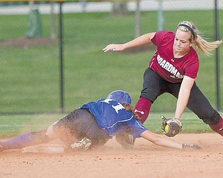 Boardman's Brooke Meenachan, successfully makes the catch but not in time to keep Madison's Ashley Palmer from safely arriving at second base during the first inning of the 2010 Div. 1 Regional Semifinal game at the University of Akron's Lee R. Jackson Softball field.