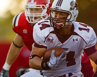 Geoffrey Hauschild|The Vindicator.Southern Illinois' Joe Allaria (14) runs downfield to score a final touchdown for the Salukis during the fourth quarter of a game at Youngstown State University's Stambaugh Stadium on Saturday afternoon.