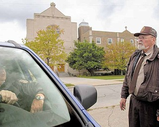 Bob Jacobs, of Youngstown, and Wally Heck, of New Springfield, talk Sunday morning while working security outside St. Dominic Church, 77 E. Lucis Ave. Thomas J. Repchic, 75, and Jacqueline Repchic, 74, two St. Dominic parishioners, were shot Saturday afternoon near the intersection of Southern Boulevard and Philadelphia Avenue. Thomas Repchic died of his injures, and his wife is in the hospital. They're the second and third St. Dom's members to fall victim to a shooting this year.