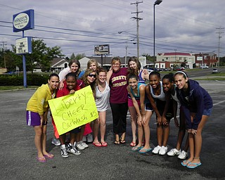 7th and 8th grade Liberty cheerleaders spend a Saturday afternoon throwing a carwash to raise money.