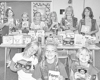 Under the guidance of their troop leader, Vicki Palmer, members of Girl Scout Troop 420 of Canfield, discussed what to do with the money they earned selling Girl Scout cookies. The girls, all third-graders, came up with the idea to buy books for kids in the hospital. The troop contacted a local wholesaler about purchasing $100 worth of books. The wholesaler responded with a box full of donated books. The books will be donated to Akron Children's Hospital of Mahoning Valley at 4:45 p.m. Monday. The girls are, front, from left to right, Peyton Munera, Holly Eberly and Abby Palmer. In the back are Julie Porterfield, Ella Mitchell, Grace Ramun, Libby Finsen, Anna Dudash, and Emily Porterfield. Missing from the picture is another of the 10 troop members, Zoe Guzman.