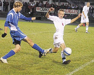 Daniel Rumsey of Salem, center, attempts to block a shot by Connor Syersal of Hubbard during a soccer game Tuesday. Salem won 3-0.