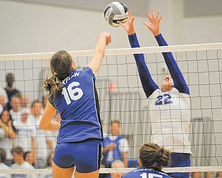 Lakeview's Marissa Naples (16) and Hubbard's Haley Turner (22) battle for the ball at the net during an All-American Conference White Tier contest Thursday at Hubbard. The Bulldogs defeated the Eagles three games to none to maintain a perfect record.