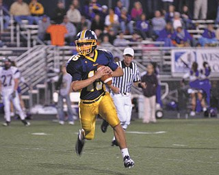 Josh Tekac, quarterback for Wilmington Area Greyhounds, is shown as he rolls out to pass during a recent home game.