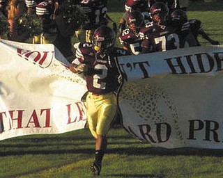 Robert Smith-Harris leads the Liberty Leopards onto the field.
