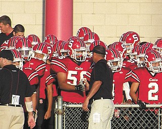 Struthers Wildcats coach Ron Iarussi wishes his son, senior Keary Iarussi, No. 56, good luck before a recent game.