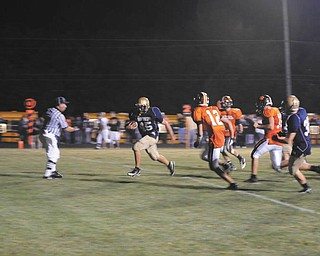 Lowellville Rocket No. 45 Geno Tkach makes a touchdown during the Springfield game.