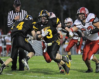 Crestview's Adam Coppock splits the Columbian defence on his way to Crestview's 1st TD during their game at Crestview on Friday night. Photo/Mark Stahl