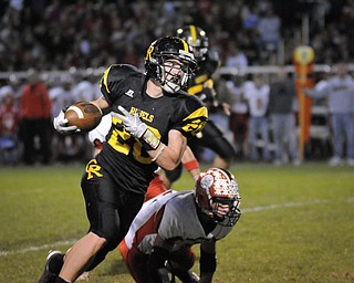 Crerstview's Andrew Mayer runs against the Columbiana defence during their game at Crestview on Friday night. Photo/Mark Stahl