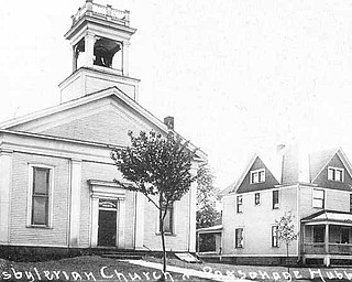 This photo shows the historic First Presbyterian Church and its parsonage that occupied the southeast corner of West Liberty and Hager streets in Hubbard. The church, built in 1857, was renovated in 1891 and 1923. It was dismantled in the 1990s and will be reassembled in Harding Park. In 1959, the church rebuilt on Westview Avenue in Hubbard.