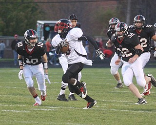 FOOTBALL - Ja'les Hughes is off to the end zone as he out runs (10) Zach Penick and (32) Charles Shrontz Friday night in Salem. - Special to The Vindicator/Nick Mays