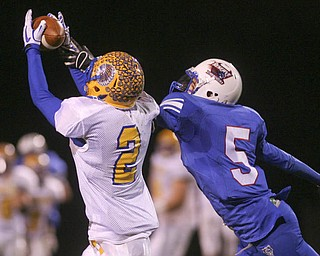 ROBERT K. YOSAY | THE VINDICATOR..Easy catch as Indians Trey Griffith hauls in a pass defending is Blu Devils #  John Rosati - Western Reserve Blue Devils  vs Southern Local Indians at Western Reserve Stadium ..-30-..
