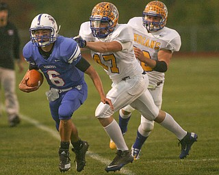 ROBERT K. YOSAY | THE VINDICATOR.. Shovin him out of bounds is Indians #47  NO NAME - Western Reserve Blue Devils  vs Southern Local Indians at Western Reserve Stadium ..-30-..