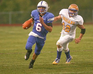 ROBERT K. YOSAY | THE VINDICATOR.. QB  #6 blue Devils Jeffrey Clegg  takes off for the sidelines to set up another Blue devil first down - chasing him is #12  Josh Melhorn - Western Reserve Blue Devils  vs Southern Local Indians at Western Reserve Stadium ..-30-..