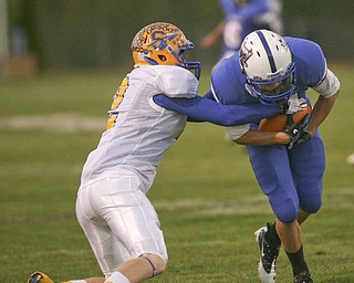 ROBERT K. YOSAY | THE VINDICATOR.. Indians #2  Trey Griffith  attempts to bring down #5  John Rosati of Blue Devils after a first down pass  in the first half - Western Reserve Blue Devils  vs Southern Local Indians at Western Reserve Stadium ..-30-..