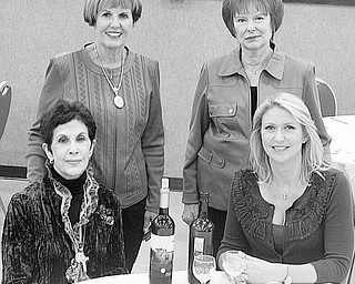 Nick Mays | Special to The Vindicator: Standing, from left, Julie Costas, Geri Kosar, and seated, Jeanne Saadey and Cindy Matthews are ready for the Rich Center fundraiser titled Napa Valley to the Mahoning Valley. The annual event will take place Oct. 23 at Our Lady of Mount Carmel Church hall.